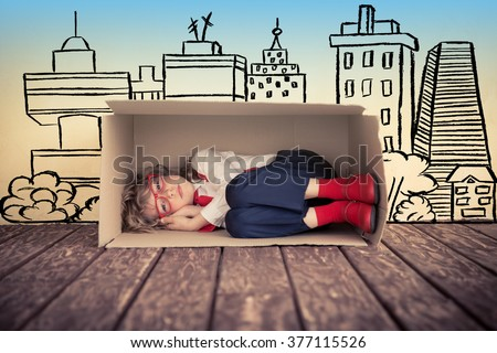 Portrait of young businessman kid in office. Real estate concept