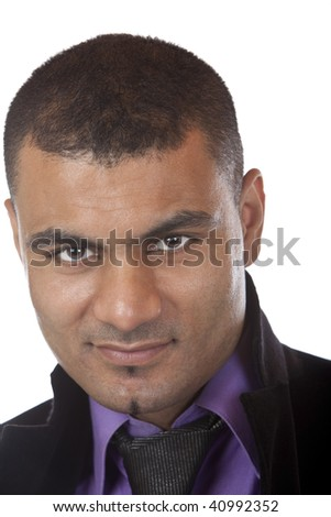 Portrait of young businessman standing casual and looks into camera. Isolated on white.
