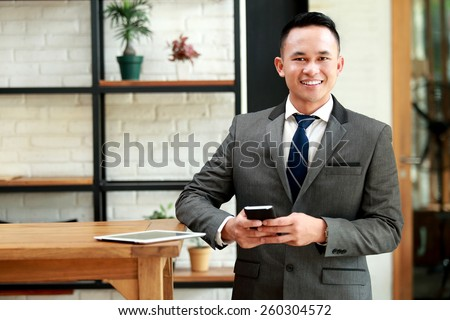portrait of young businessman waiting for meeting appointment at cafe - stock photo