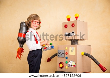 Portrait of young businessman with jet pack and robot. Success, creative and innovation technology concept. Copy space for your text - stock photo