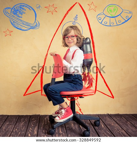 Portrait of young businessman with jetpack riding office chair. Success, creative and innovation technology concept. Copy space for your text - stock photo