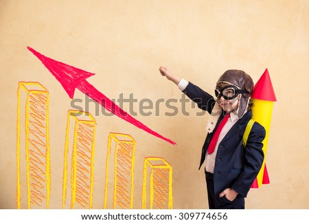 Portrait of young businessman with paper rocket. Success, creative and start up concept. Copy space for your text - stock photo