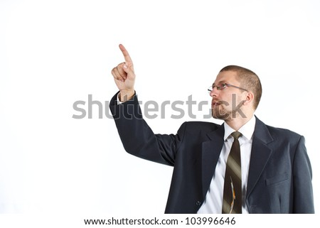 Portrait of young businessman with suit, tie, glasses, pointing up - isolated on white - stock photo