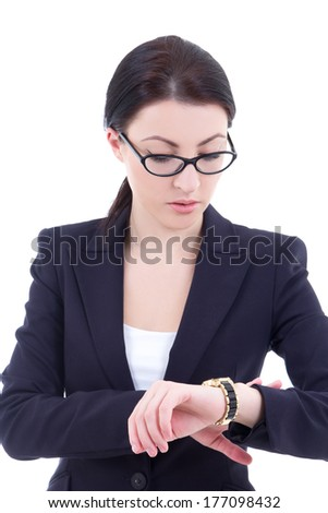portrait of young businesswoman checks time on her wrist watch isolated on white background - stock photo