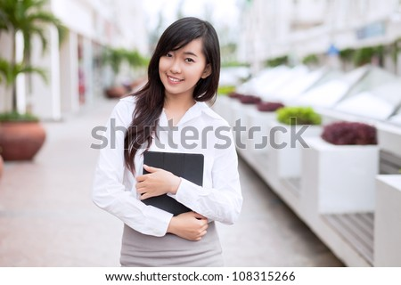 Portrait of young businesswoman looking at camera - stock photo