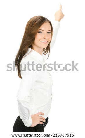 Portrait of young businesswoman pointing at something in her back, isolated on white background - stock photo