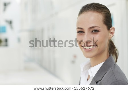 Portrait of young businesswoman smiling - stock photo