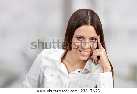 Portrait of young businesswoman with charming smile.