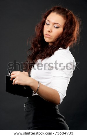 Portrait of young businesswoman with empty wallet