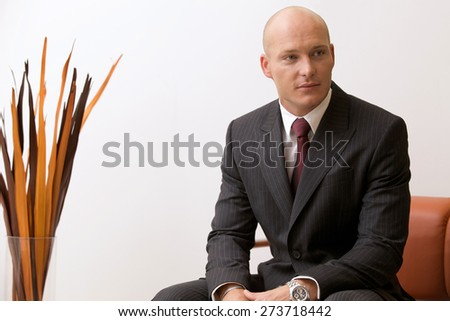 Portrait of young caucasian businessman in office - stock photo