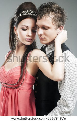 Portrait of Young Caucasian Couple in Love Posing in Studio. Vertical Image Composition - stock photo