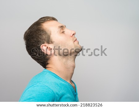 Portrait of Young Caucasian man relaxing with closed eyes - stock photo