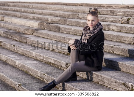 Portrait of Young Caucasian Teenager Girl Sitting On Stairs Outdoors.Horizontal Image Orientation - stock photo