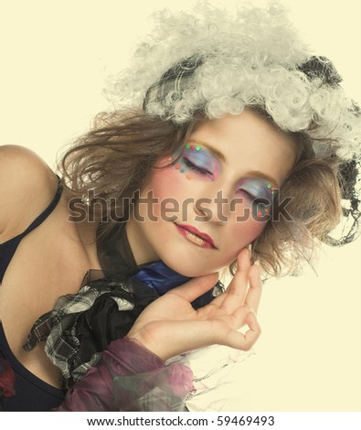 Portrait of young charming lady in creative image.