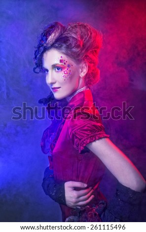 Portrait of young charming woman in artistic image. - stock photo