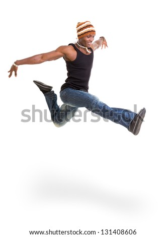 Portrait of young cheerful african american man jumping isolated on white - stock photo