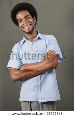 Portrait of young cheerful african american man standing in casual pose - stock photo