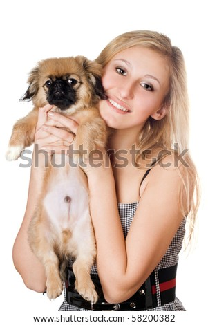 Portrait of young cheerful blonde with a puppy. Isolated on white