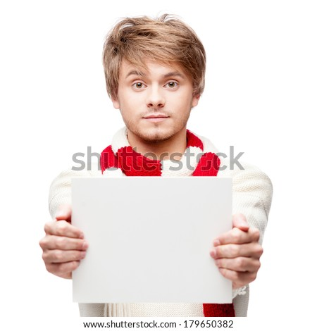 portrait of young cheerful caucasian man which holding sign with funny expression - stock photo