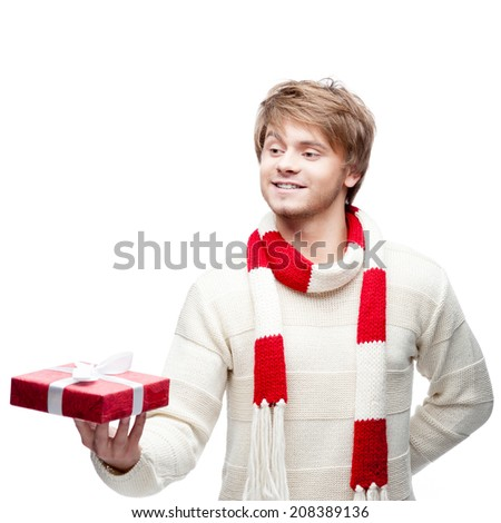 portrait of young cheerful smiling caucasian man which holding christmas gift with happy smile - stock photo