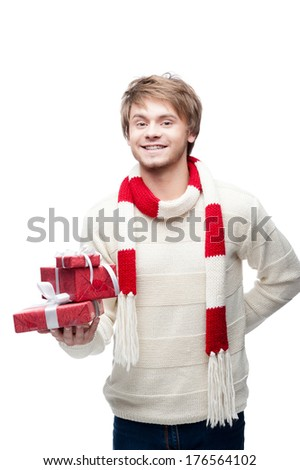 portrait of young cheerful smiling caucasian man which holding christmas gifts with happy smile - stock photo
