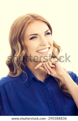 Portrait of young cheerful smiling thinking blond businesswoman in blue clothing - stock photo