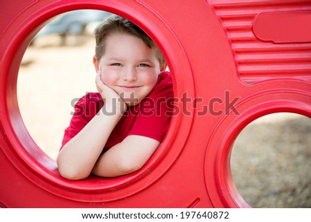 Portrait of young child playing on playground  - stock photo