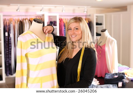 Portrait of young clothing designer - stock photo