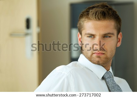portrait of young confident caucasian businessman