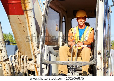 Portrait of young construction worker driving forklift, front view