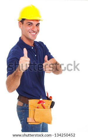 portrait of young constructor giving thumbs up over white background - stock photo