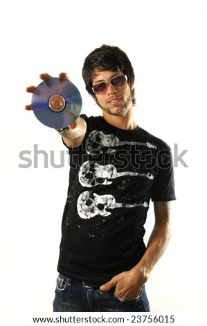 Portrait of young cool man holding a cd - dvd isolated - stock photo