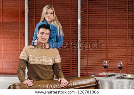 portrait of young couple at the modern apartment - stock photo