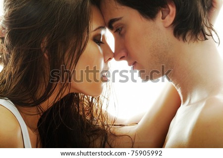 Portrait of young couple face to face