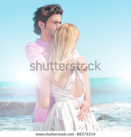 Portrait of young couple in love embracing at beach and enjoying time being together. Idealistic artistic  photo poster for advertisement banner - stock photo