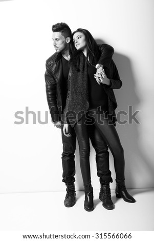 Portrait of young couple in love posing at studio. Fashion photo.