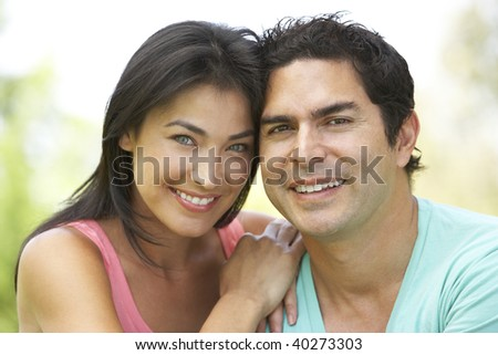 Portrait Of Young Couple In Park - stock photo