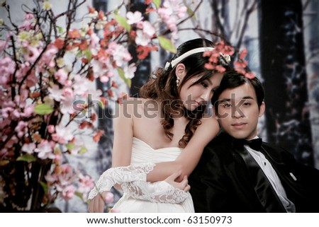 Portrait of young couple in romantic action - stock photo