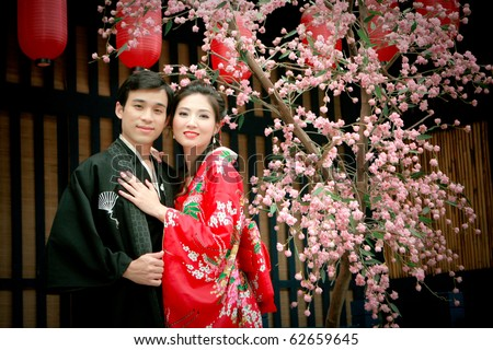 Portrait of young couple in yukata dress hugging each other - stock photo