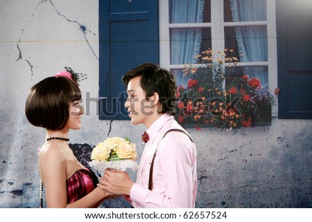 Portrait of young couple looking each other - stock photo