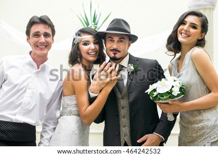 portrait of young couple of just married with their friends