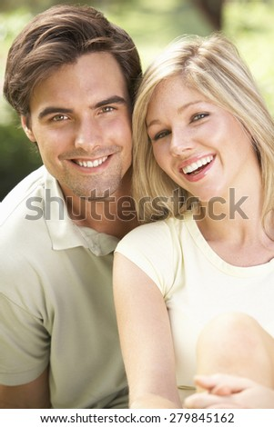 Portrait Of Young Couple Relaxing In Countryside