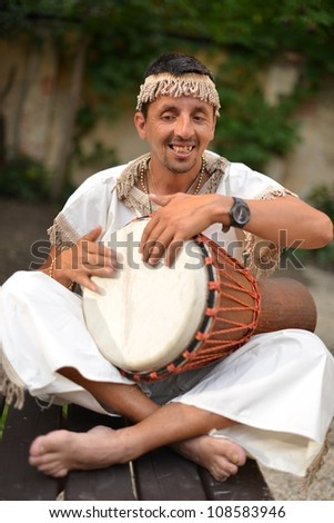 Portrait of young cuban percussionist performing live - stock photo