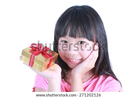 Portrait of young cute girl holding a present - stock photo