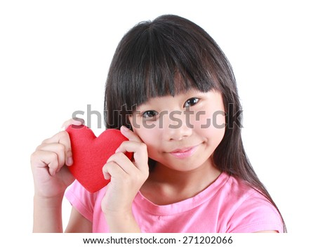 Portrait of young cute girl with red heart - stock photo