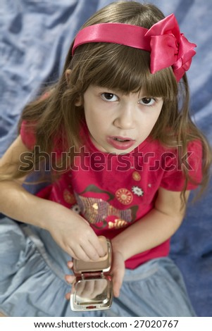 portrait of young cute girl withpowder doing make up