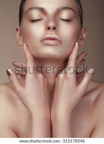 Portrait of Young Cute Woman with Bronzed Skin - stock photo