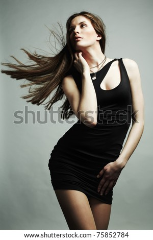 Portrait of young dancing girl with flying dark hair - stock photo