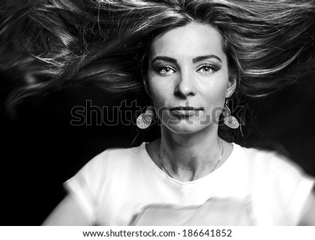 Portrait of young dancing woman with long flowing hair. Fashion photo - stock photo