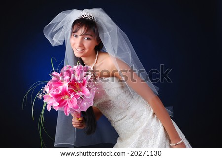 portrait of young dark-hair bride with bouquet of lilys